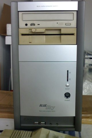 The PC case from the front, containing CD and 1541 drive